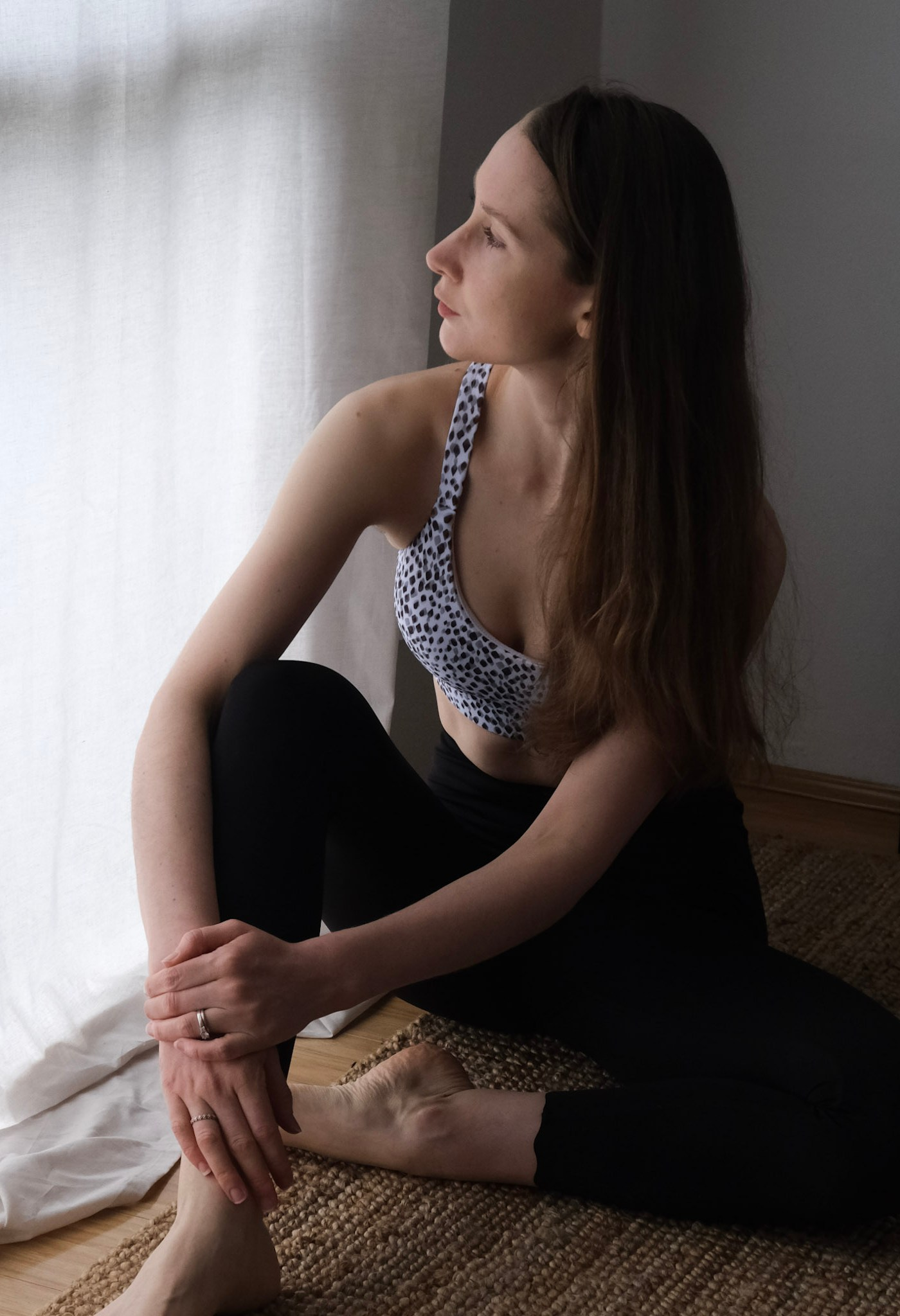 Girl standing in front of white curtains wearing DK Active Saviour crop and Dharma Bums 7/8 scallop leggings in black, sustainable active wear review, DK Active brand review, Australian brands, sustainable clothing, minimalist active wear, active wear capsule wardrobe
