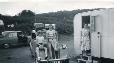 Sitting on the family Ford Anglia while on holiday, Anglesey late 1950s