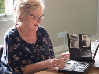 Margaret looking at her family photograph album