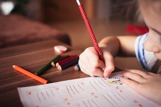 Dyslexia - Little girl writing.