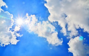 blue sky with sun and clouds