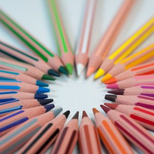 spectrum of colored pencils arranged in a circle