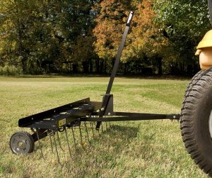 lawn dethatching behind tractor 300x251 - Stop Crabgrass with Pre-emergent Weed Control