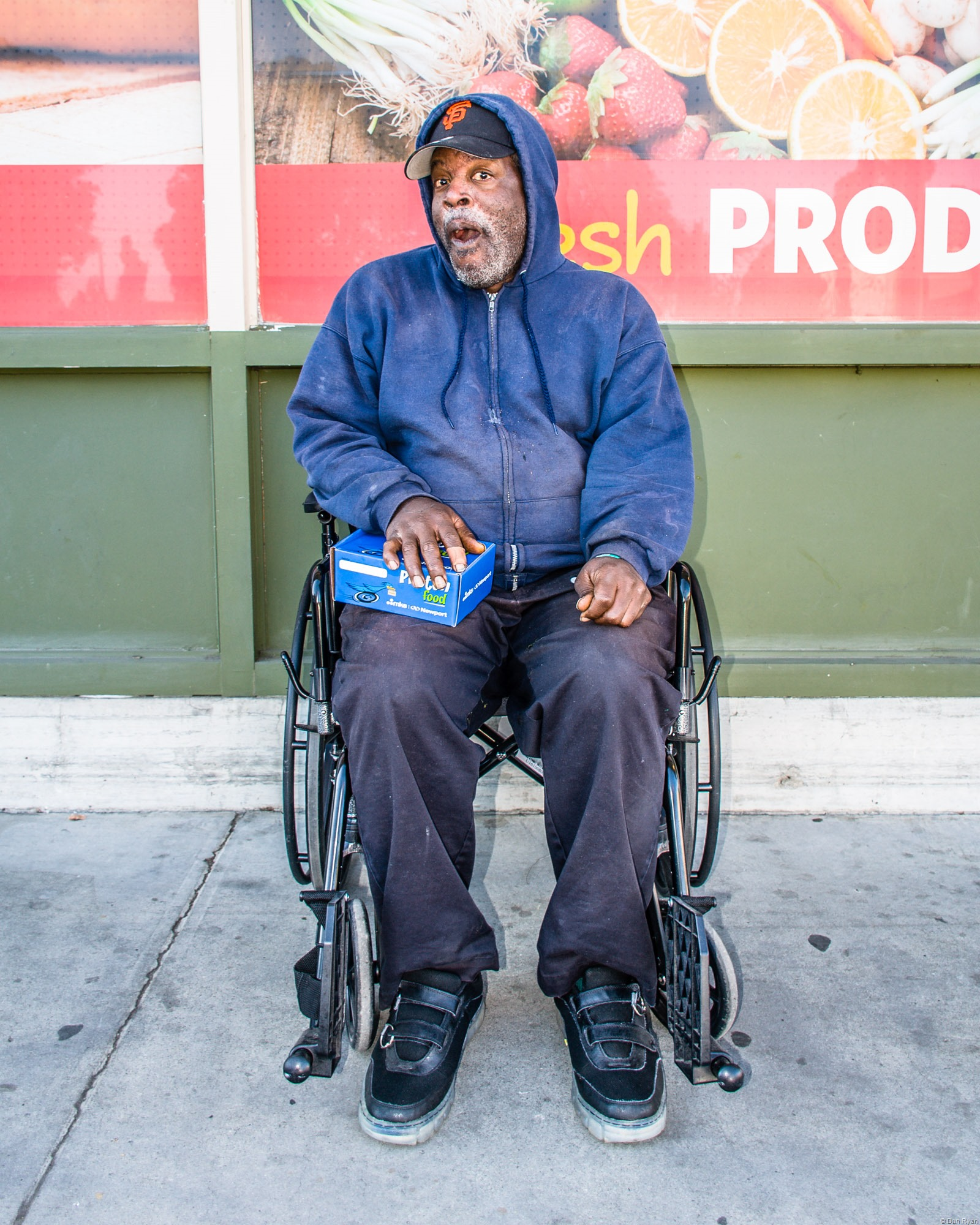 Homeless man in wheel chair at a grocery store