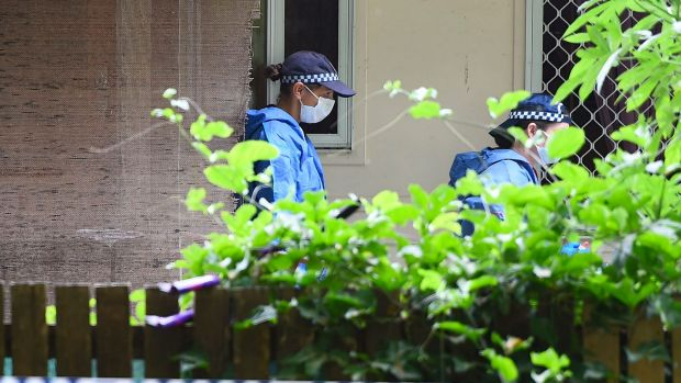 Police forensic officers continue the investigation.