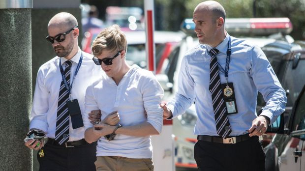 A member of Tiahleigh Palmer's foster family arrives at Logan police station on Tuesday.