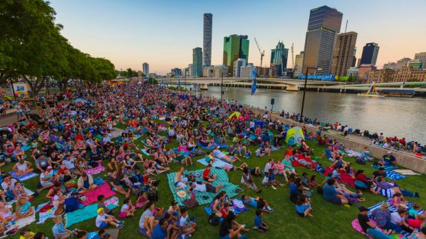 Crowds eagerly await fireworks at South Bank during New Year's Eve celebrations.
