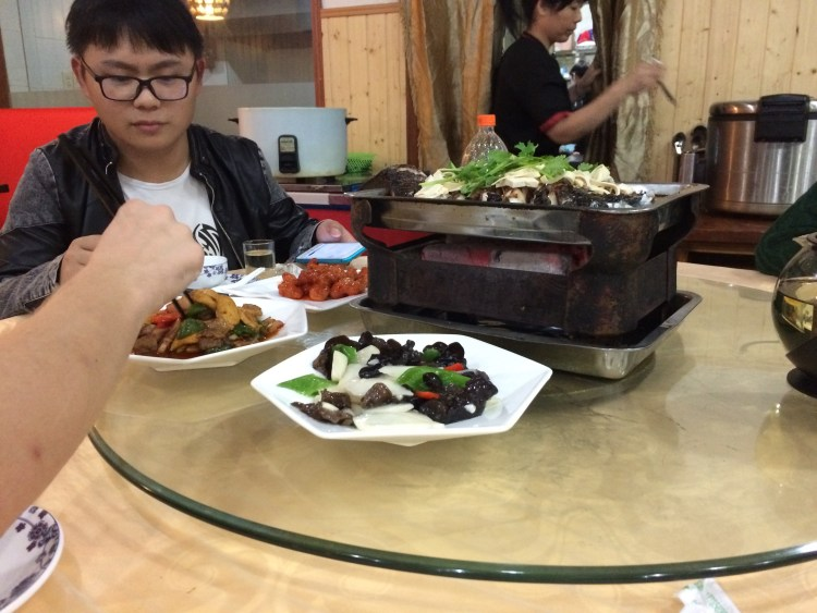 Sharing food in Hangzhou, on a revolving table, very clever.