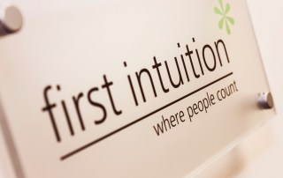 First Intuition logo on sign