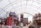 Warehouse and storage fabric building showing aircraft parts and other equipment