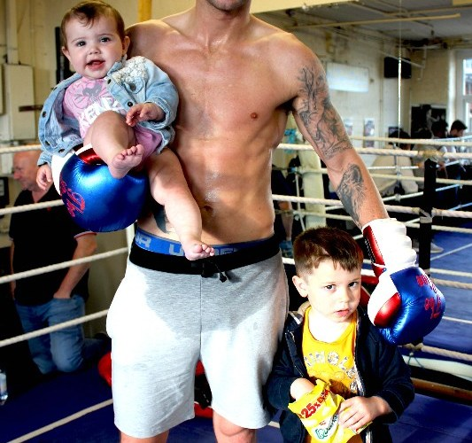 Brian Rose with his two children at the gym after training
