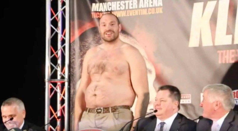 tyson fury takes off top at press conference fat
