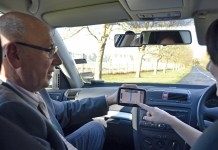 emily and assessor inside car with satnav
