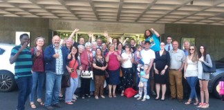 The Deaf Association celebrate the news outside the meeting.