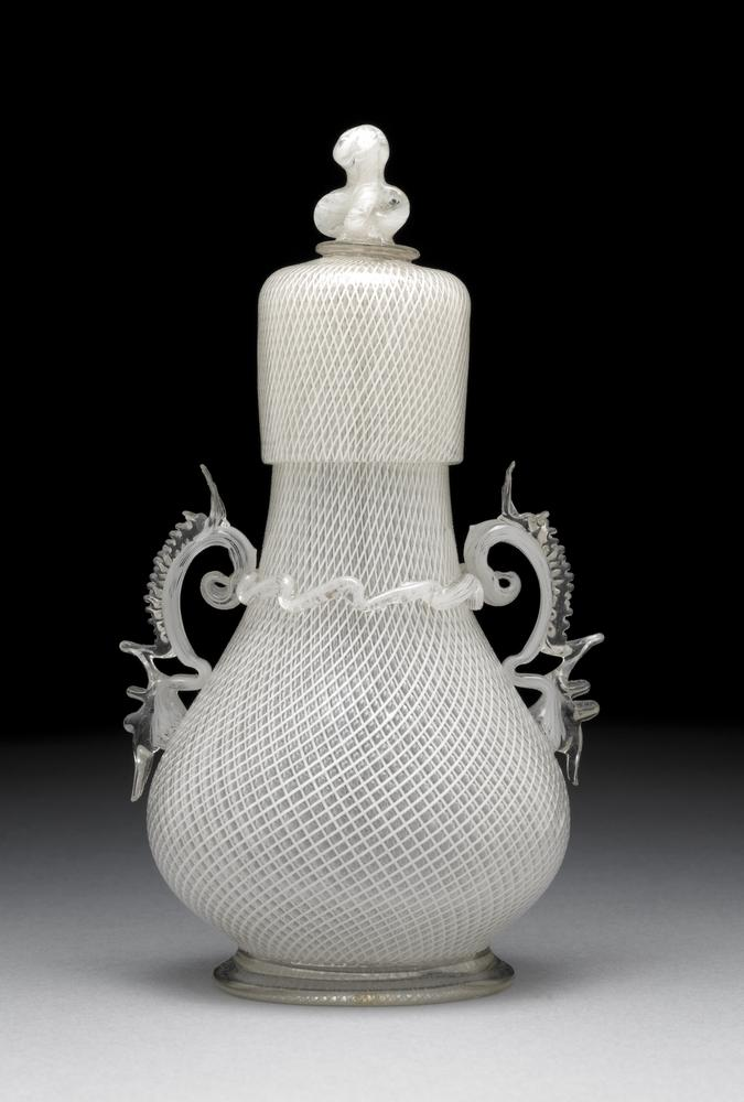 Flacon and cover; glass; globular body with cylindrical neck on clear base-ring; whole ornamented with fine reticelli work except wings and base rim.