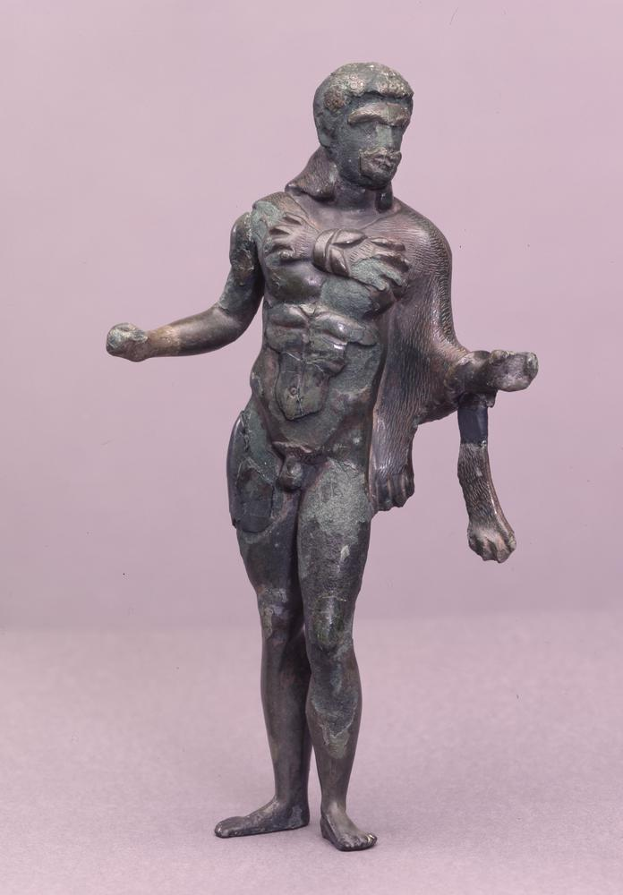 Bronze figure of Herakles; corroded with separate fragments.