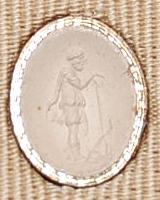 Plasma gem engraved with Faustulus (?) wearing a tunic, skin cloak and boots, and leaning on a staff; at his feet is a dog.
