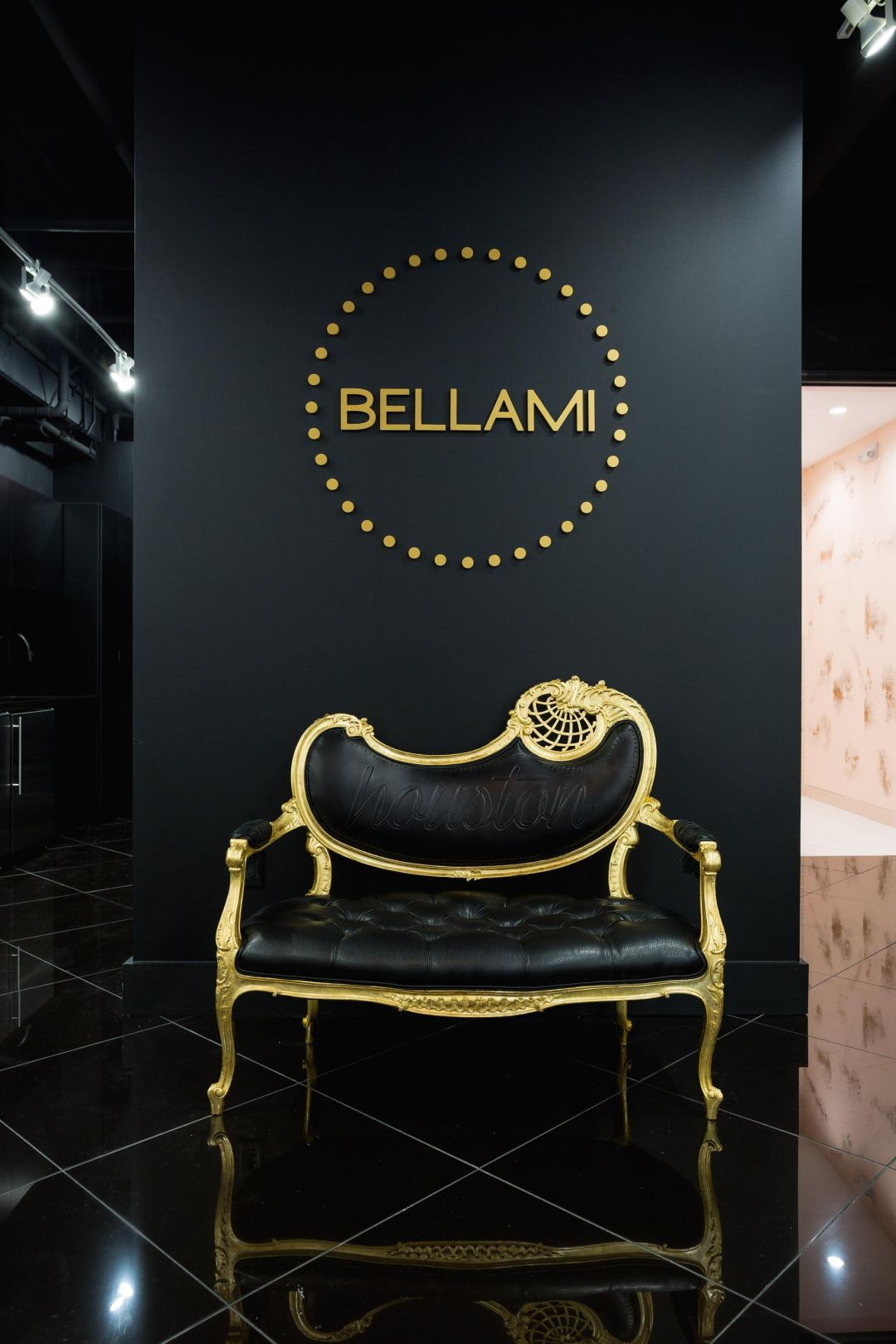 black and gold bellami wall and couch