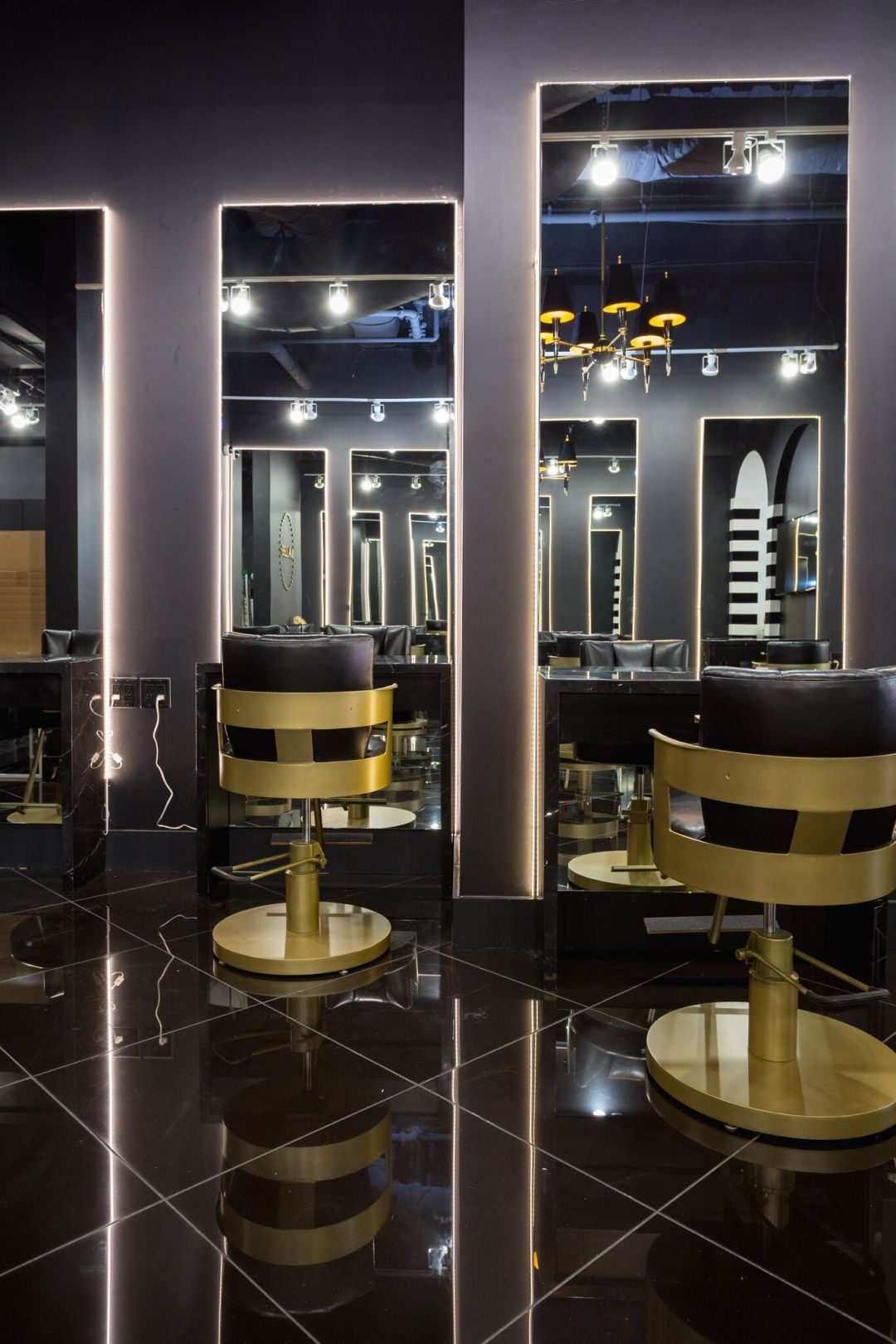 black and gold experiential retail by BE