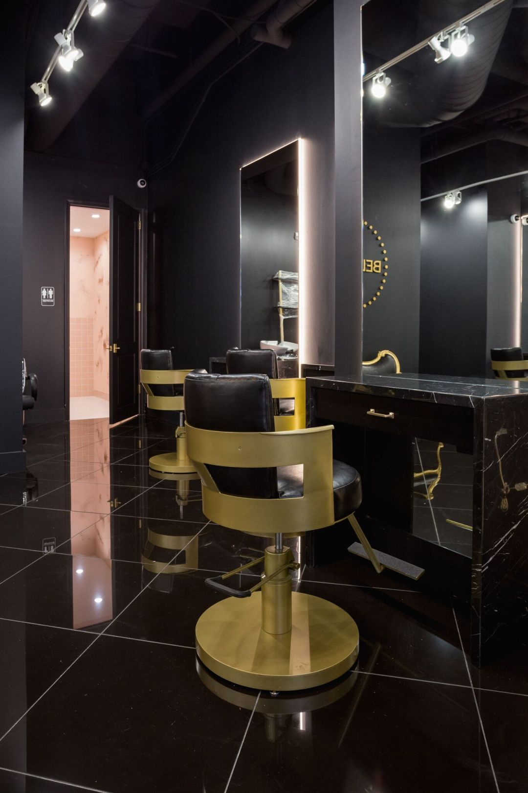 gold stools surrounded by black marble