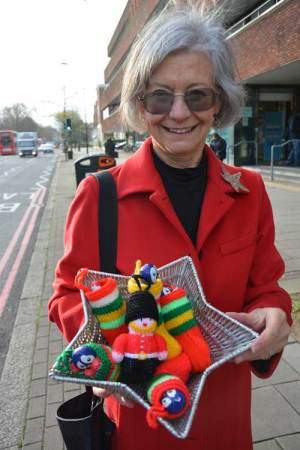 Edith Holtham, chair of the Friends of Tate South Lambeth Library, with some of the knitted decorations