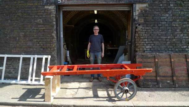 The barrow stripped back to its chassis and one axle