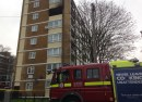 A fire engine can be seen outside a blackened fifth-floor flat