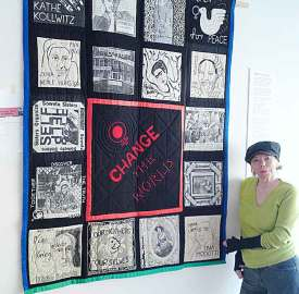 Teri Bullen hanging her historic patchwork of revolutionary women – Change the World! At the Brixton Calling! Exhibition in the 198 Gallery in 2011. Picture: Stefan Szczelkun/Flickr/Creative Commoms