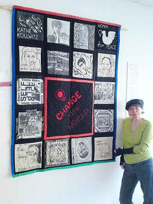 Teri Bullen hanging her historic patchwork of revolutionary women – Change the World! At the Brixton Calling! Exhibition in the 198 Gallery in 2011. Picture: Stefan Szczelkun/Flickr/Creative Commons