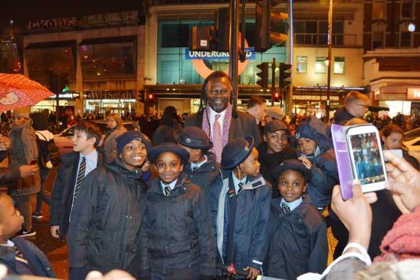 Levi Roots poses for pictures with the Corpus Christi choir