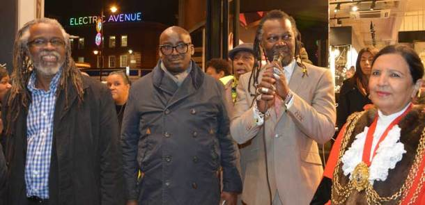 The lights are on – Brixton BID's Michael Smith and Stafford Geohagen with levi Roots and mayor