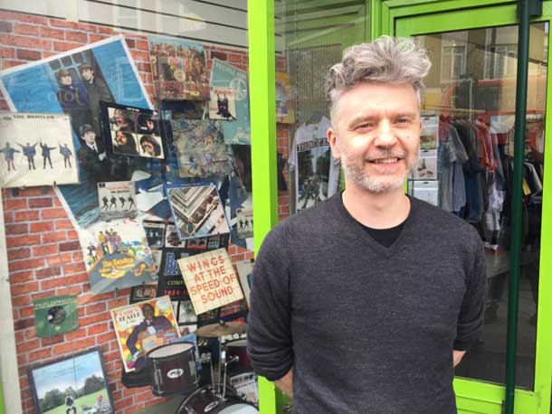 Brixton Barnardo's store Manager Russell Lewendon in front of the Beatles-themed window he's put together for Record Store Day / the Beatles-themed window at Brixton Barnardo's.