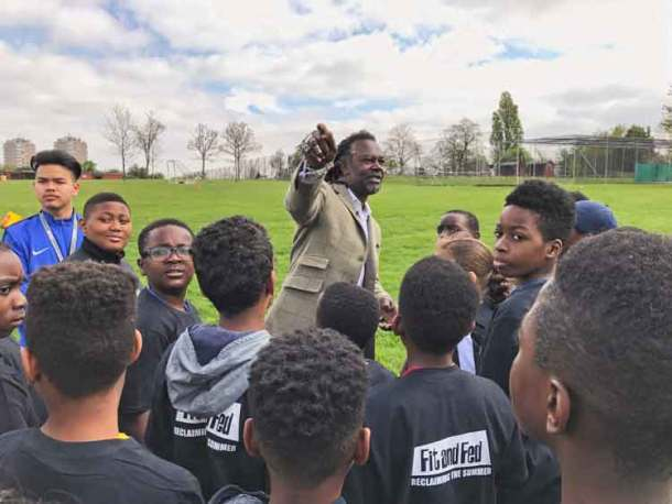 I used to live just over there … Levi Roots talking to young football players in Brockwell Park