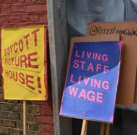 Ritzy livi9ng wage campaign placards