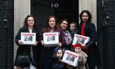Comedian Russell Brand joins residents and supporters from the New Era housing estate as they deliver a petition to 10 Downing Street. Photograph: Dan Kitwood/Getty Images