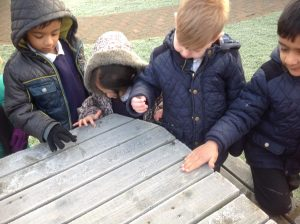 Discovering we can write our names in the frost.  'Very cold,' said Kylan-Jak.