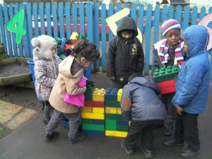 After sharing the book, 'The Three Billy Goats Gruff', we designed our own bridge on paper and then built it using large bricks.