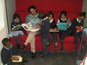 Mrs Patel enjoys using the library just as much as the children!