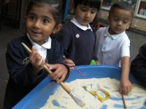 We have been drawing letters and mark making in the sand tray.