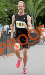 Photo of Brock sprinting to the finish line