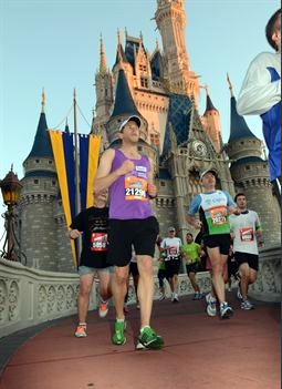 Photo of me running past the iconic Disney Castle