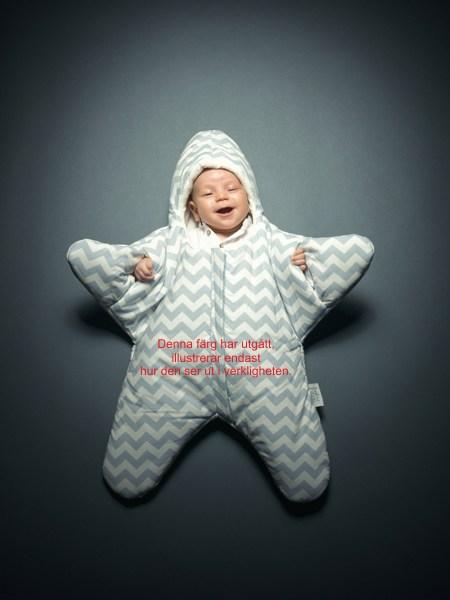 Stjärnformad sovsäck till baby med brodyr.