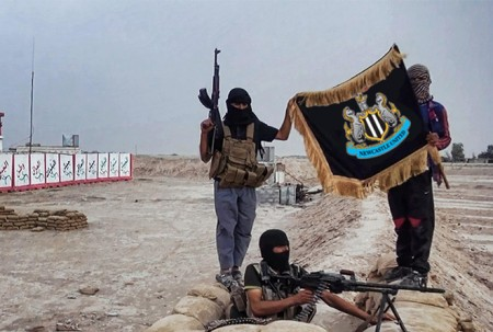 Forgetful-ISIS-jihadist-takes-wrong-flag-from-home