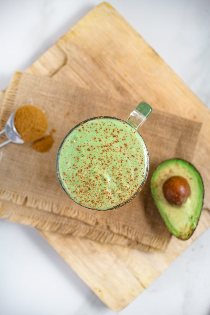 Avocado Smoothie   Keto & Vegan Recipe. This breakfast smoothie is strikes a delicate balance between coconut and avocado, with a hint of cinnamon to bind it all together. #keto #vegan #easy #ketorecipes #veganrecipes #ketovegan #lowcarb