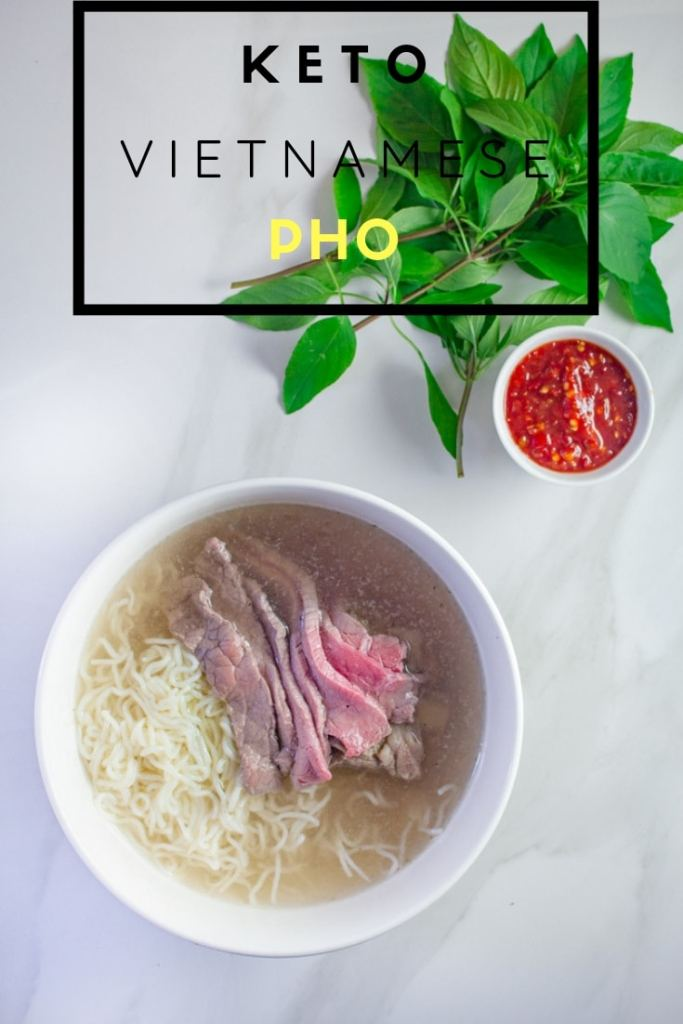 Bowl of Pho next to Thai Basil and Chili paste