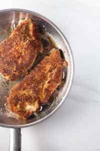 keto chicken cutlets in frying pan
