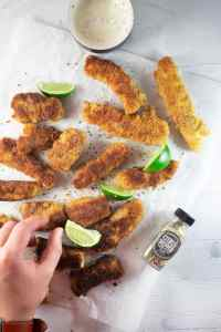 Keto Fish Sticks served with lime wedges