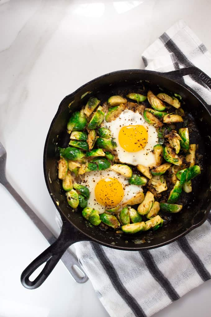 Keto Brussels Sprouts with Eggs in cast iron pan