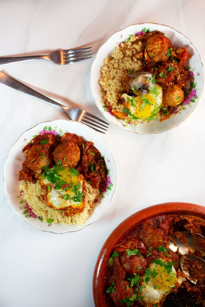 Eggs and Kafta Tagine served on top of couscous.