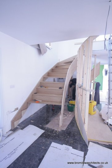 Curved staircase under construction.